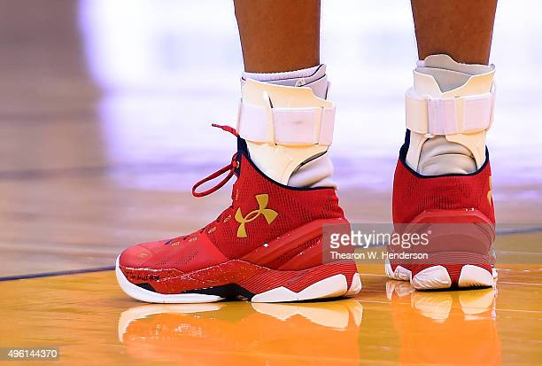 A detailed view of the Under Armour basketball shoes worn by Stephen Curry of the Golden State Warriors against the Denver Nuggets during their NBA...