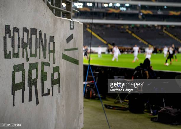 Detailed view of the wall of the Frankfurt fan block with the inscription 'Corona Area' inside the stadium prior to the UEFA Europa League round of...