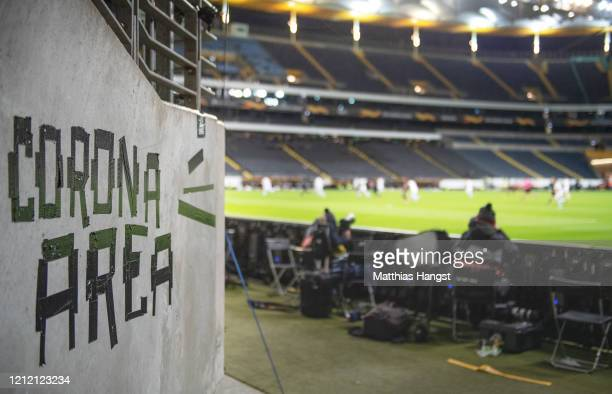 A sign named Corona Area is seen inside the stadium during the UEFA Europa League round of 16 first leg match between Eintracht Frankfurt and FC...