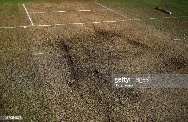 Detailed view of the wicket as strong winds and heavy rain force a section of the covers to blow off and damage the pitch resulting in an abandonment...