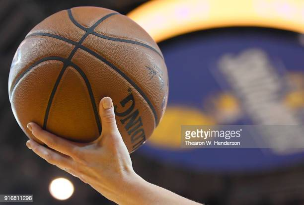 A detailed view ot the official Spalding NBA basketball held in the air by referee Lauren Holtkamp during an NBA basketball game between the Oklahoma...