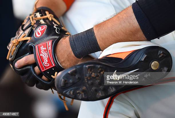 A detailed view ot the Rawlings Baseball glove and Nike cleats used by Brandon Crawford of the San Francisco Giants while he sits on the bench prior...
