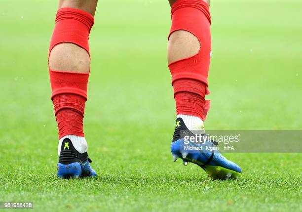 Detailed view showing holes in socks of Yohan Ben Alouane of Tunisia during the 2018 FIFA World Cup Russia group G match between Belgium and Tunisia...