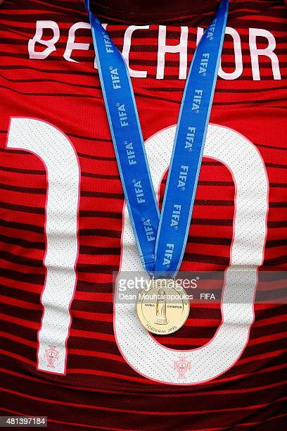A detailed view the number 10 shirt worn by Belchior of Portugal and his gold medal after winning the FIFA Beach Soccer World Cup Final between...