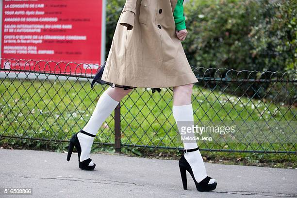 a guest wears white high rise socks under black heels at the Chanel show at Grand Palais on March 07 2016 in Paris France