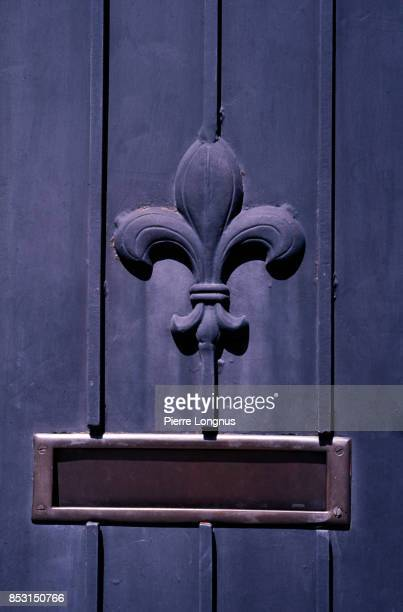 """Details of a door with """"Fleur de Lys"""" (symbol of the King of France) in the French Quarter of New Orleans, Louisiana, USA"""
