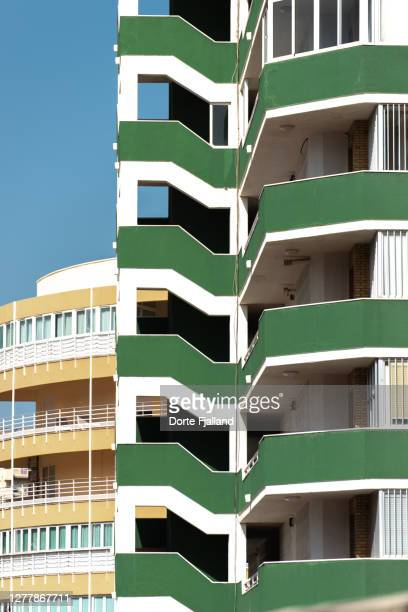 details of a green building with a yellow building and blue sky in the background - dorte fjalland fotografías e imágenes de stock
