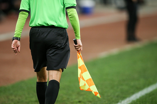 Details of a linesman referee during a soccer game 1135377558