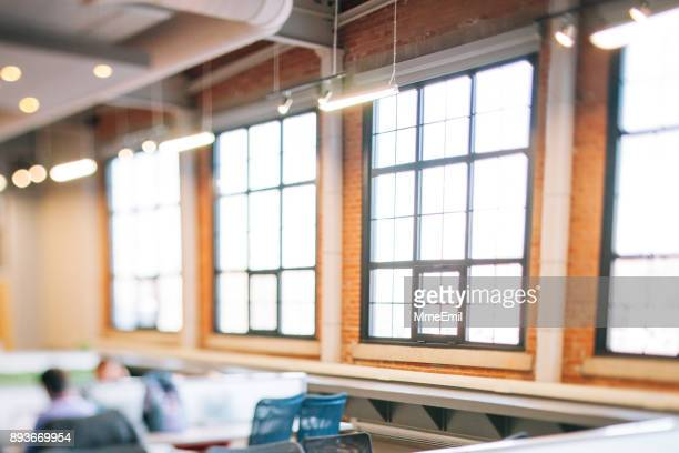 details of a modern commercial and industrial building corridor renovated, revamped and refurbished. new business background. startup. open plan workspace. - accessorio per le lampade foto e immagini stock