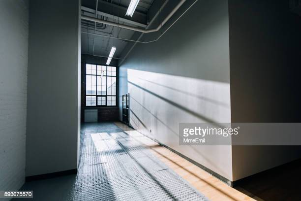 Details of a modern commercial and industrial building corridor renovated, revamped and refurbished. New business background. Startup. Empty open plan workspace.
