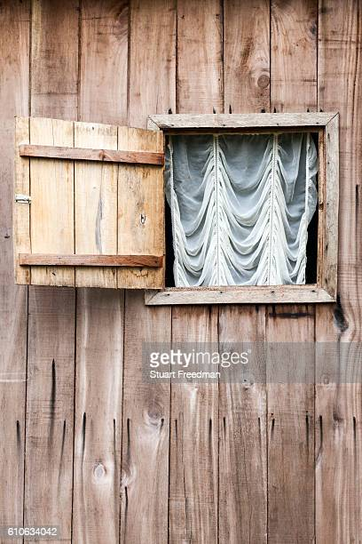 Details of a net curtain in a clapboard house Principe Sao Tome and Principe Sao Tome and Principe are two islands of volcanic origin lying off the...