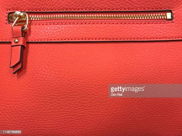 details of a red handbag showing side metal zipper - leather purse stock pictures, royalty-free photos & images