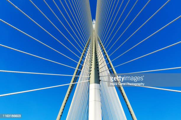 details of bridge cable-stayed bridge against blue sky - prop stock pictures, royalty-free photos & images