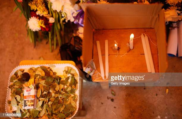 Details of candles and coca leaves coca during the funeral ceremony of Rudy Cristian Vásquez who was killed during clashes with police at the Senkata...