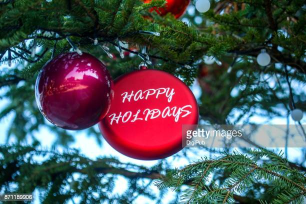 """details of christmas tree """"happy holidays"""" with copy space - happy holidays stock photos and pictures"""