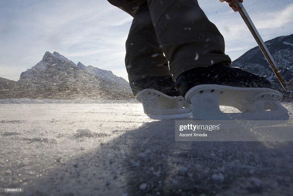 Details of skates turning on frozen pond, hockey : Stock Photo