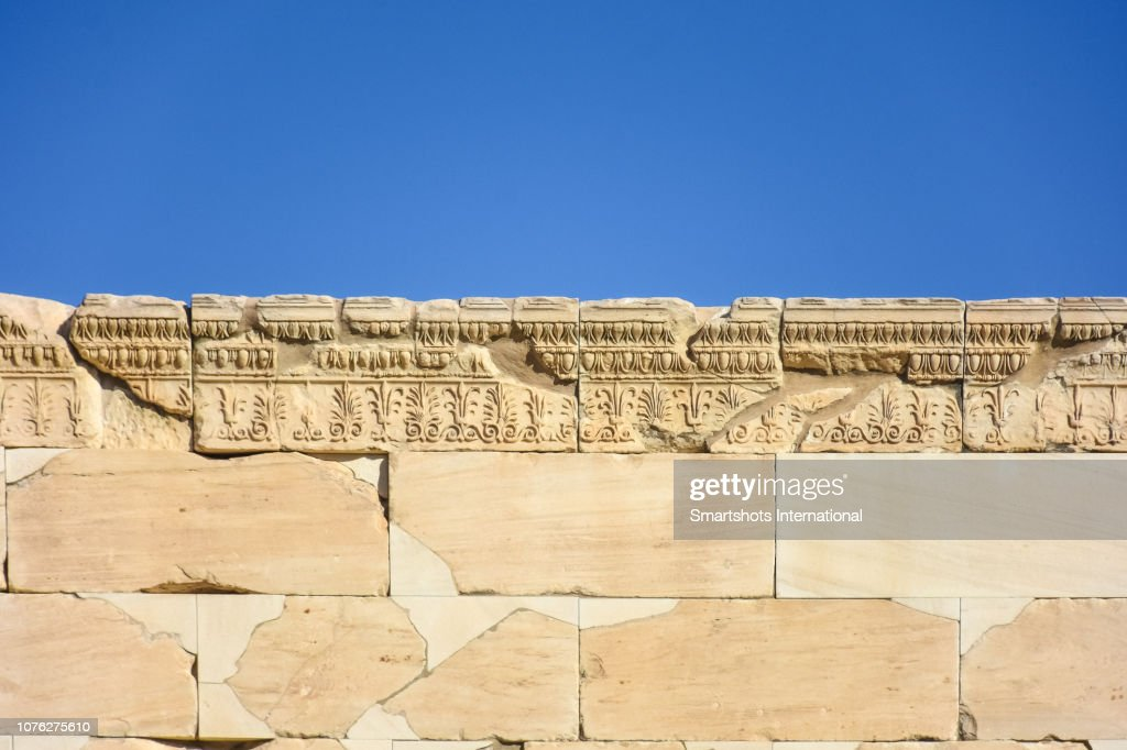 Details of the carved stones on top of the Porch of the Caryatids in The Erechtheion, Temple of Athena and Poseidon, Acropolis, Athens, Greece : Stock Photo
