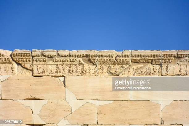 details of the carved stones on top of the porch of the caryatids in the erechtheion, temple of athena and poseidon, acropolis, athens, greece - ancient greece photos stock pictures, royalty-free photos & images