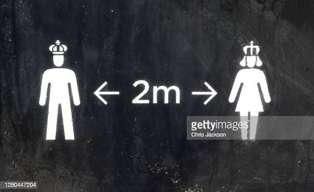 Details of the signage encouraging social distancing at the reopening of the Tudor gardens at Hampton Court Palace on June 18, 2020 in London,...