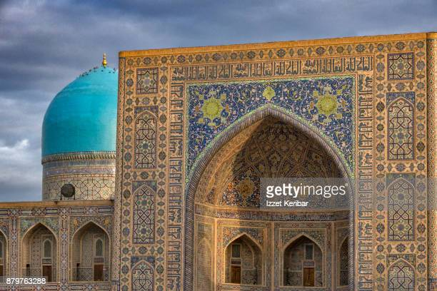 Details of Tillya Kori Madrasah turquoise coupola and entrance at Registan ensemble, Samarkand, Uzbekistan