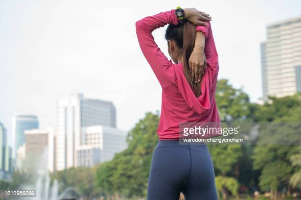 details of women exercise in sportswear stretching in the park. - sports footwear stock pictures, royalty-free photos & images
