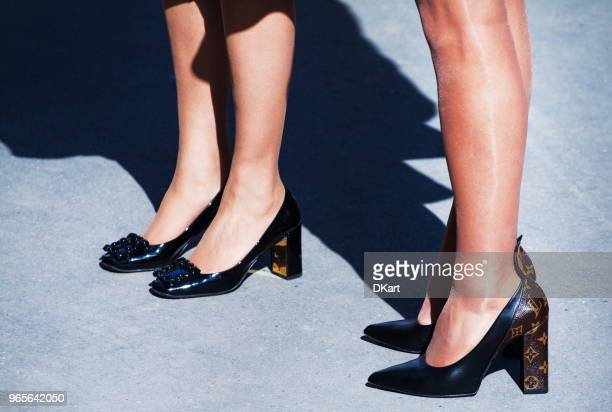 details of womens clothes and shoes on a street - louis vuitton designer label stock photos and pictures