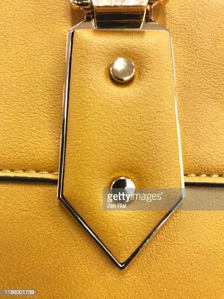 details on a yellow ladies handbag -part of handbag handle - 裁縫道具 ストックフォトと画像