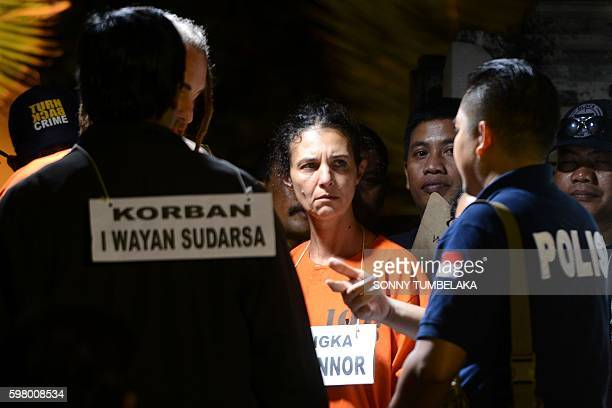 Detained Australian national Sara Connor waits for police instructions during the reenacting of events at the crime scene were an Indonesian traffic...