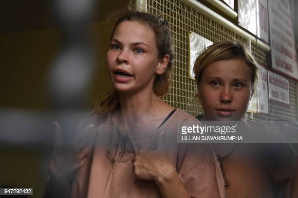 Detained Belarusian model Anastasia Vashukevich known by her pen name Nastya Rybka arrives with an unidentified fellow detainee at a holding cell to...