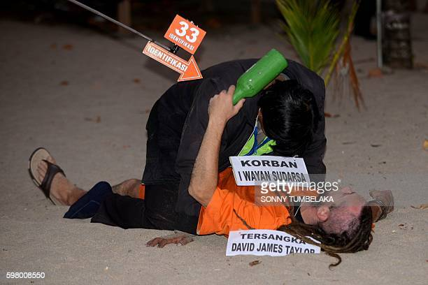 Detained British national David Taylor reenacts events at the crime scene were an Indonesian traffic policeman was killed at Legian beach in Kuta on...