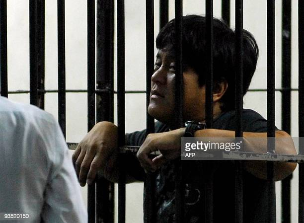 Detained Datu Unsay Mayor Andal Ampatuan Jnr talks to his lawyer from a National Bureau of Investigation detention cell in Manila on December 1 2009...