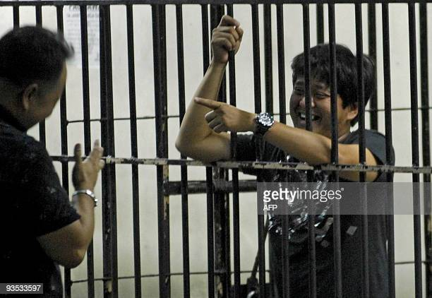 Detained Datu Unsay Mayor Andal Ampatuan Jr talks to an NBI agent at the National Bureau of Investigation detention cell in Manila on December 1 2009...
