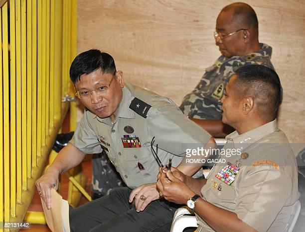 Detained military officers Brigadier General Danilo Lim Major General Renato Miranda and Colonel Ariel Querubin are seen together before the start of...