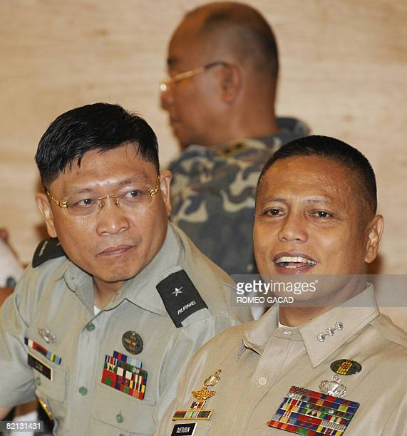 Detained military officers from Brigadier General Danilo Lim Major General Renato Miranda and Colonel Ariel Querubin are seen together before the...