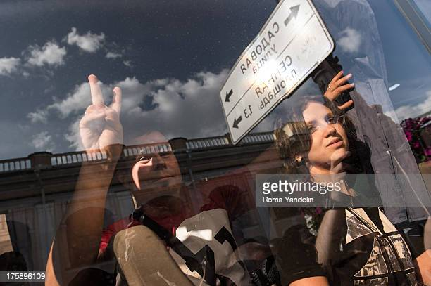 Detained opposition activists look on during a protest rally defending Article 31 of the Russian constitution, which guarantees the right of...