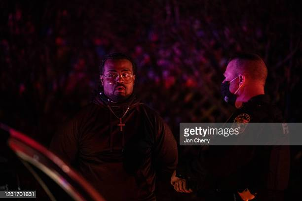 Detained protester converses with a Louisville Metro Police Department officer after the Breonna Taylor memorial events on March 13, 2021 in...