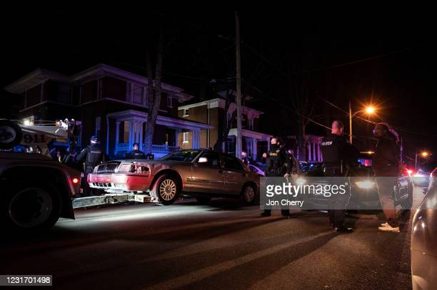 Detained protester watches as his vehicle is towed during a protest after Breonna Taylor memorial events on March 13, 2021 in Louisville, Kentucky....