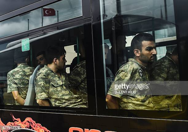 TOPSHOT Detained Turkish soldiers who allegedly took part in a military coup arrive in a bus at the courthouse in Istanbul on July 20 following the...