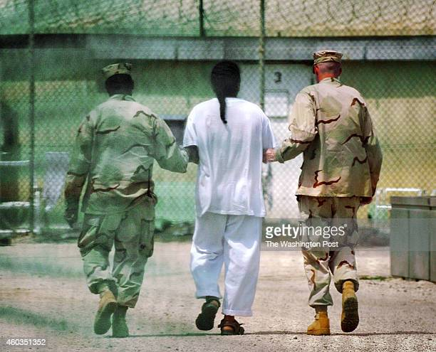 Detainee is escorted at Camp Delta detention facility in Guantanamo Bay, Cuba.We look at the high price tags on building projects at the U.S....
