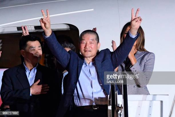 US detainee Kim Dongchul gestures upon his return with Kim Haksong and Tony Kim after they were freed by North Korea at Joint Base Andrews in...