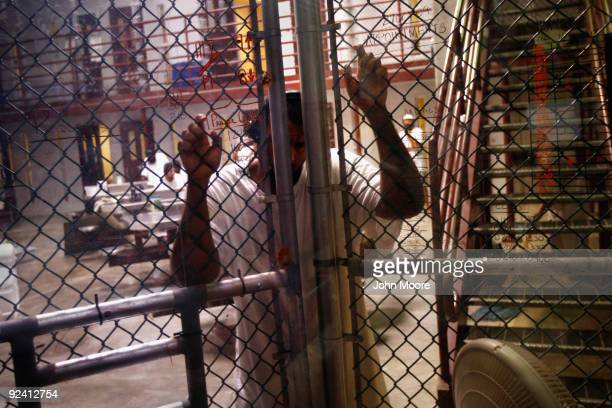 A detainee stands at an interior fence inside the US military prison for 'enemy combatants' on October 27 2009 in Guantanamo Bay Cuba Although US...