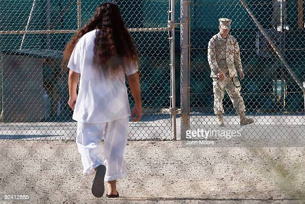 A detainee walks across a recreation ground inside the US military prison for 'enemy combatants' on October 27 2009 in Guantanamo Bay Cuba Although...