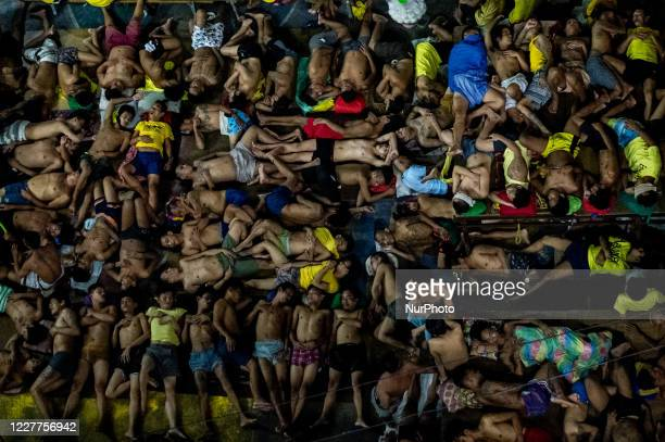 Detainees sleep at an open basketball court inside the Quezon City Jail in Quezon City, Philippines on July 24, 2020. The Quezon City Jail, which has...