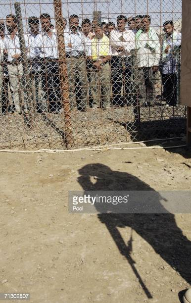 Detainees stand in the Abu Ghraib prison yard while waiting to be released on June 27 2006 in Baghdad Iraq Another 500 detainees were released from...