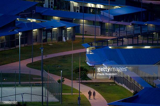 Detainees walk inside the Immigration Detention Center compound February 25 2012 on Christmas Island Australia So far in 2012 the total number of...