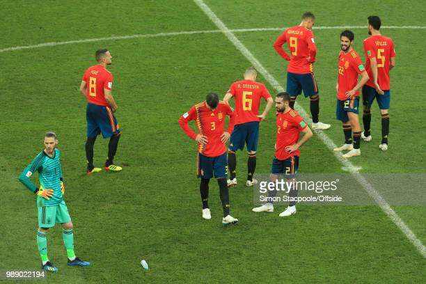 A detected Spain console one another after they are knocked out of the tournament on penalties during the 2018 FIFA World Cup Russia Round of 16...