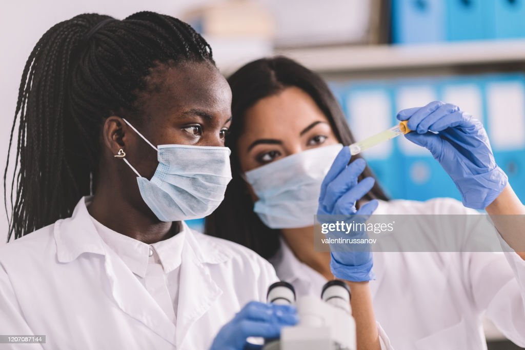 Detection of the pathogen coronavirus infection in the microbiology laboratory : Stock Photo