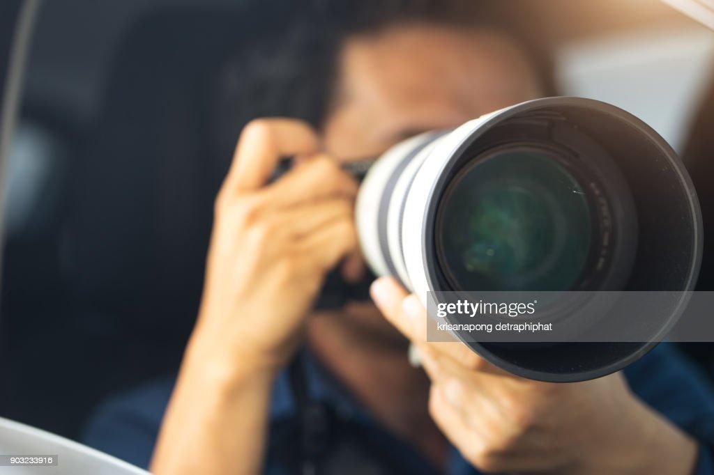 detective and Photographers : Stock Photo