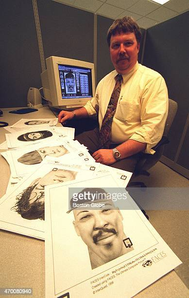 Detective Bruce Dolloff with computergenerated police 'sketches' created by a computer program that will replace sketch artists at MBTA Police...