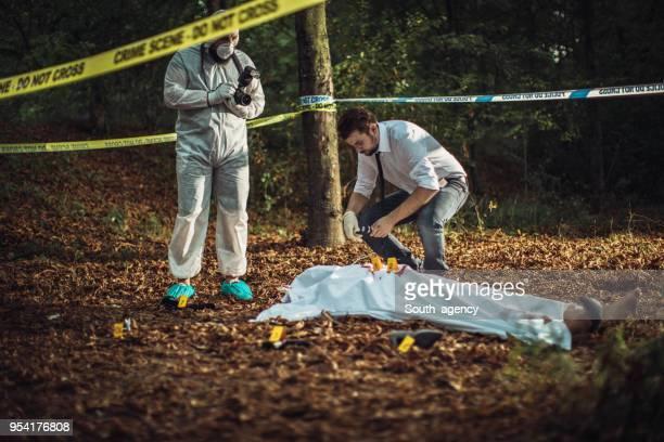 Detective examining crime scene